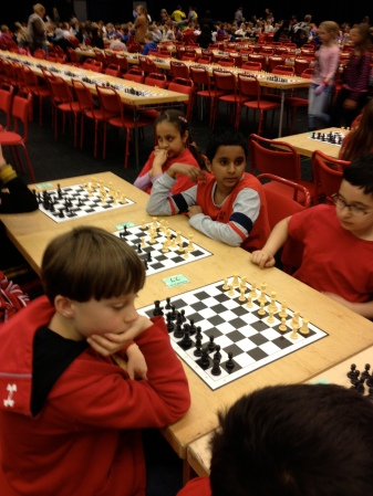 George facing his opponent during chess competition in Stockholm, April 12, 2013