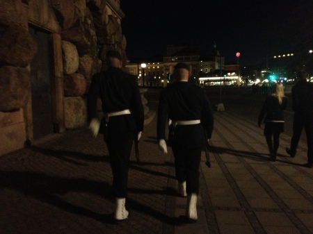 Walking behind some Swedish Royal Guards, they are on their way to relieve another guard at his post.