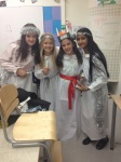 The girls in George's class all dressed as Saint Lucia's.