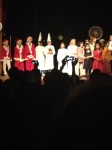The kids are all on stage after proceeding down the isle to start the evening off.
