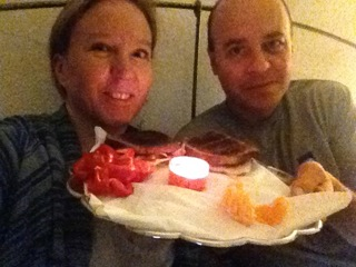 A touching gift from Maddy, breakfast in bed, candle, coffee, peeled our oranges! Sweet!