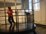 George trying to lift his friend Pepijn at the Tekniska Museet.