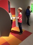 George at the Tekniska Museet (translated Museum of Technology) playing a game during the exhibit of Game On.