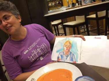 Dinner Isabel puts finishing touches on my portrait. That is not gazpacho, is it similar but with ham and egg....can't remember the name.